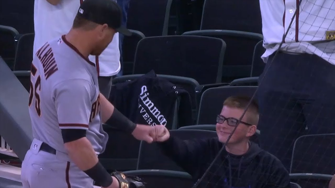 RESPECT! Kole Calhoun gives kid the rock after awesome catch!
