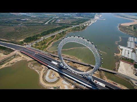चाइना ने नदी के पुल पर बनाया सबसे रोमांचक चर्खी झूला