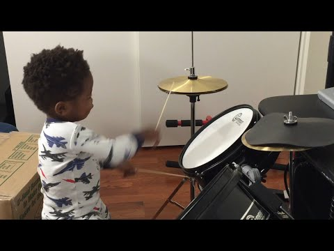 Baby playing drums