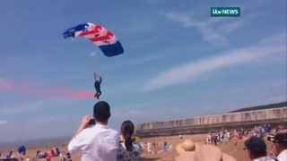 Shocking moment RAF parachutist hits burger van with a thud at air show