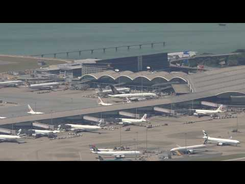 Awesome Hong Kong Airport View with aircraft landings and air traffic control