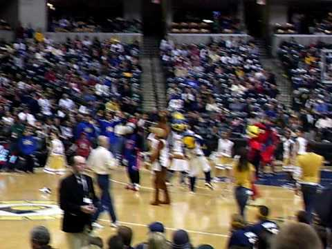 Indianapolis Pacer's Mascot (Boomer) attempts a half court shot.