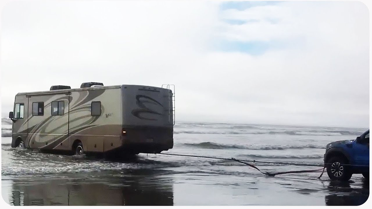 Truckers Rescue RV from Ocean