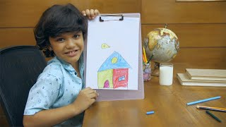Smiling Indian boy drawing and coloring a hut - art and crafts for kids