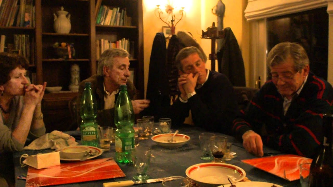 Nice Discussion At An Italian Dinner Table For Christmas