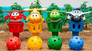 A mysterious rainbow cup on the sand  Colorful ball turns into Super Wings