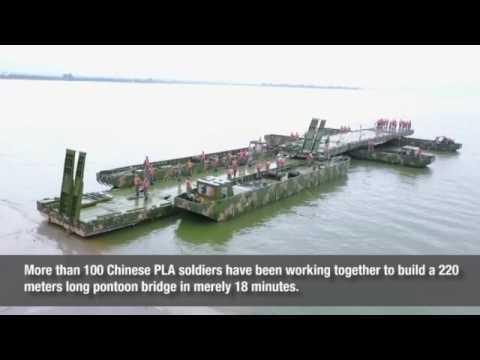 Chinese PLA soldiers build 220 meters long pontoon bridge in merely 18 minutes