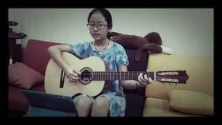 Con gái đánh đàn guitar và hát bài Color of the wind