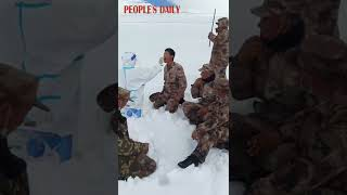 Medical workers trudged through the knee-deep snow to collect nucleic acid samples for border guards