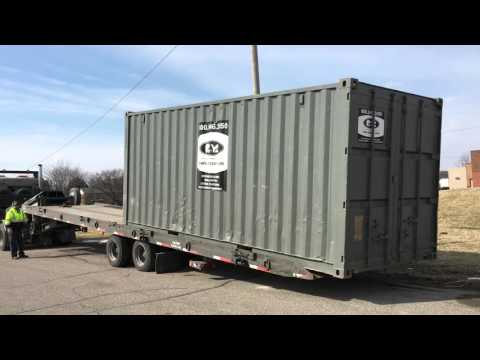 Pac-Van delivering 20' Storage Container