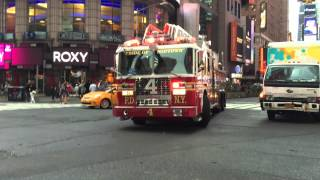 FDNY LADDER 4 RESPONDING ON WEST 42ND STREET IN THE TIMES SQUARE AREA OF MANHATTAN IN NEW YORK CITY.