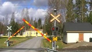 Finnish express train 883 passed Pertti level crossing