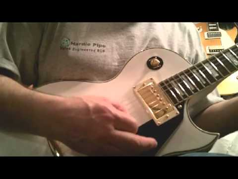 Elite lp style Guitar Model white with Gold hardware demo