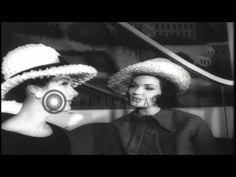 Women showcase row rimmed, stripped and various other hats during a fashion previ...HD Stock Footage