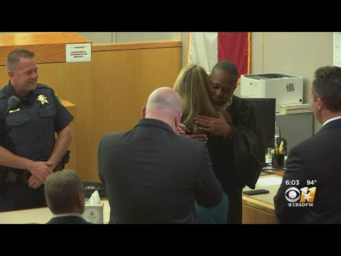 State District Judge Tammy Kemp Hugs Amber Guyger, Prays With Her