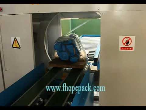 horizontal stretch wrapper for motor packing on tray
