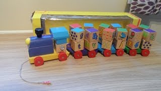 Sainburys Wooden Pull Along Spinning Kindergarten Blocks Toy Train