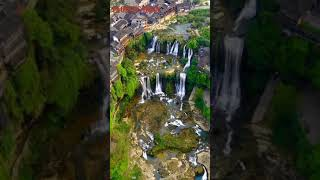 Enjoy the different beauty of the day and night in the ancient village built atop a waterfall