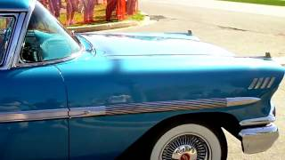 Classic cars leaving car show (Riviera Boattail, too)