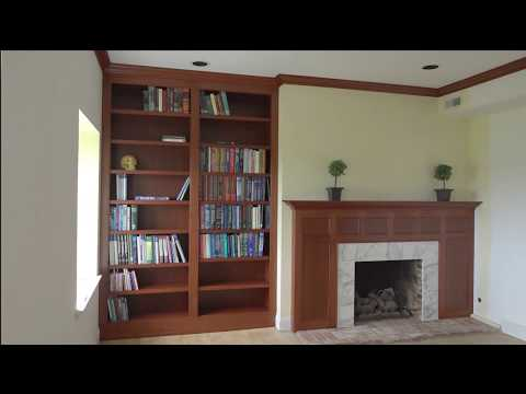 Custom built-in bookcase with fireplace paneling and mantle