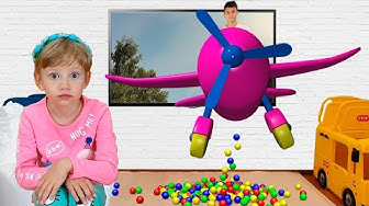 Alena and Pasha watch cartoons on TV and play outdoor games