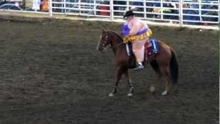 JJ Harris rides a Rodeo Queen's horse