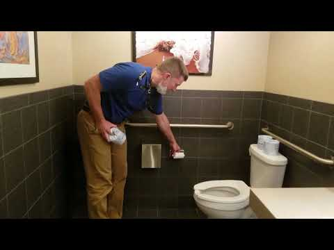 how to change commercial toilet paper roll holder