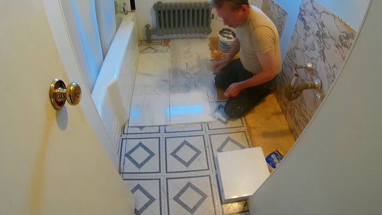 Starting To Install A Marble Tile Floor In The Bathroom