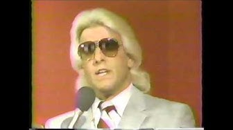 Ric Flair receives the 1985 Wrestler of the Year award from PWI