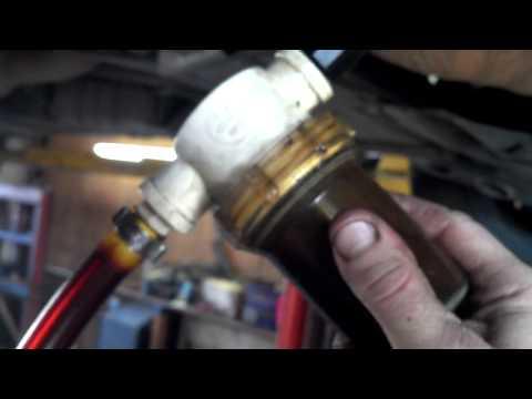 Engine sludge removal