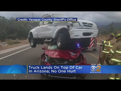 Truck Lands On Car In Arizona