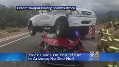Truck Lands On Car In Arizona