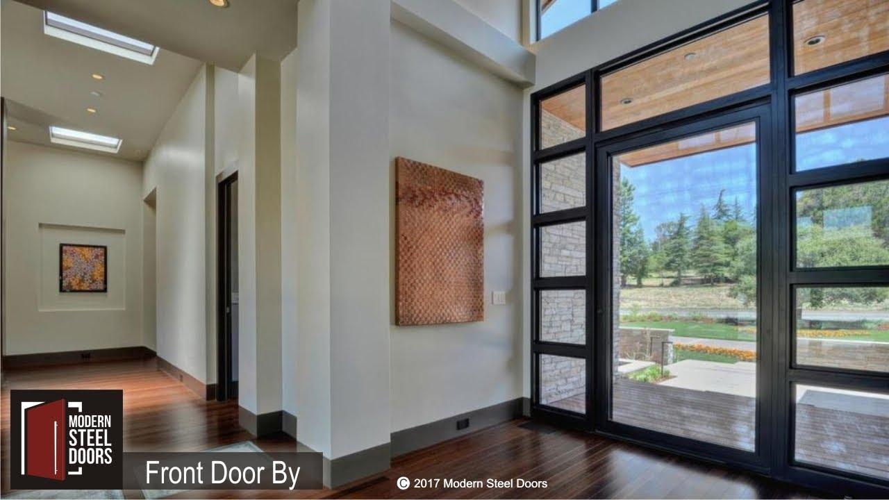 Glass & Metal Pivoting Front Door by Modern Steel Doors