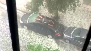 Crazy Hail Storm... And Crazy Guy Trying To Protect His Car
