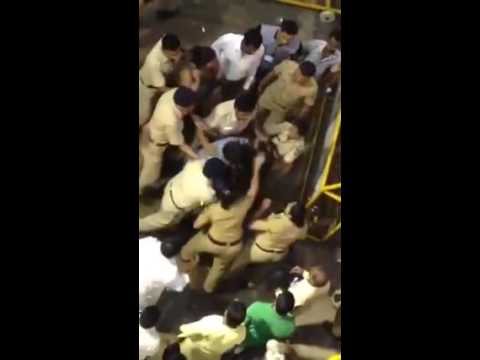 Indian Woman thrashed by Mumbai lady cops