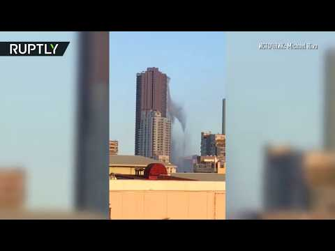 Землетрясение на Филиппинах: вода с крыши небоскрёба выплёскивается на улицу