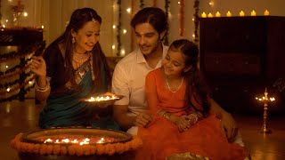 Indian family decorating the house on the occasion of Diwali - Festival Concept