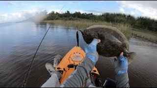 Grinding for flounder, Kayak fishing Texas Marsh