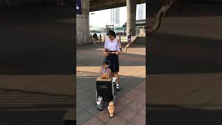 Thai girl pretending student earn a lot of money from tourists