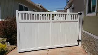 Motorised single swing gate, white vinyl privacy with picket on top.