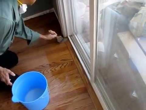 Applying Final Coat Of Water Based Polyurethane On Hardwood Floor