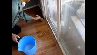 Applying final coat of Water-Based Polyurethane on Hardwood Floor