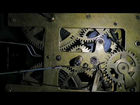 Old antique big Anglo-Swiss wall clock mechanism