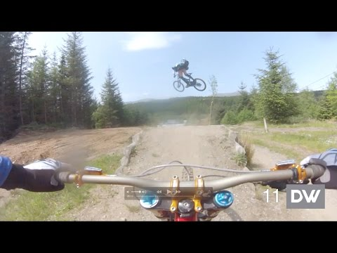 Three men in Kilts ride Fort William World Cup DH track.