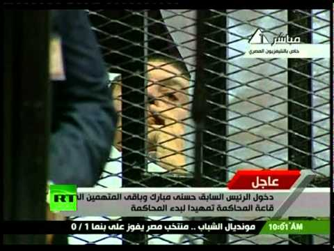 Video of Hosni Mubarak wheeled into cage on stretcher for Egypt trial