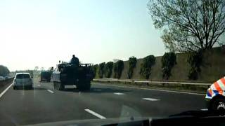 M113 armored personnel carrier at full speed on Highway