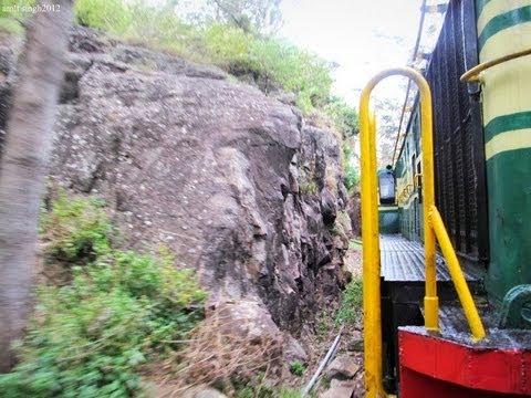 Nilgiri Mountain Railway GOC YDM4 entering Tunnel in drizzling weather before Ketti