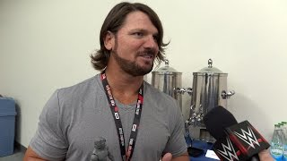 AJ Styles reacts to his action figure at SDCC 2016