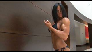Repeat youtube video Beautiful Fitness girl with huge boobs flexing her muscles