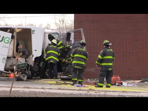 Clifton NJ Fire Dept Operates at an Accident with a Truck vs Building with Entrapment
